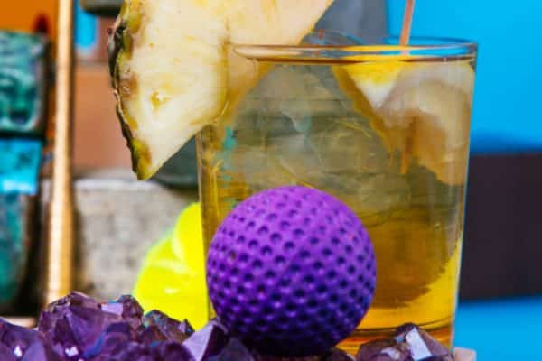golf ball and pineapple drink