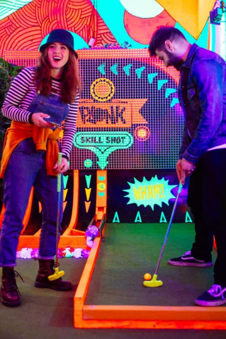 shoreditch couple enjoying plonk crazy golf