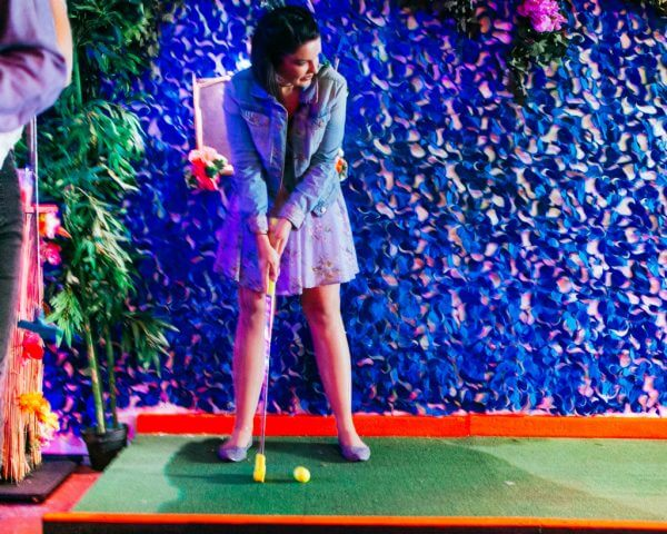 girl playing crazy golf